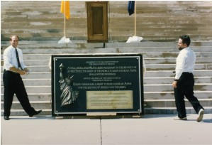 Brass Roots founder Jon Coon with Brass Roots Michigan  activist Mike DeVore displaying the Plaque in front of the Michigan State Capital Building.  It was presented at a second rally in 1995.