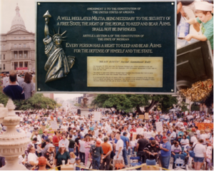 The Brass Roots Plaque (Foreground).  People at the original rally (background).